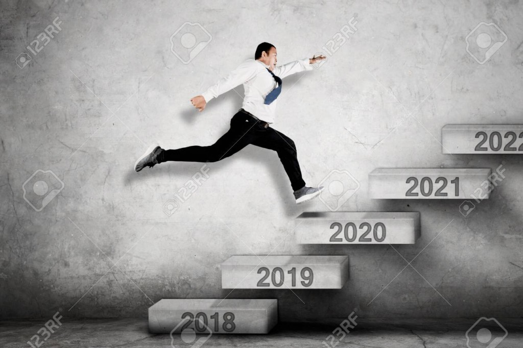Man running up steps with years 2020 to 2021 on them